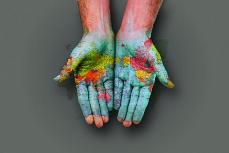 a global map painted on hands